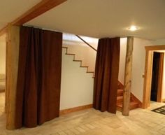 """soundproof curtains for the top of stairs. """"We suggest using heavy duty Kirsch® traverse drapery rods for most applications. You choose whether your Quiet Curtains are center-opening or side opening (note from which side you'd like them to open). For Quiet Curtains which are extra-long (and heavy), we recommend a professional ADC® track that we can order for you."""""""