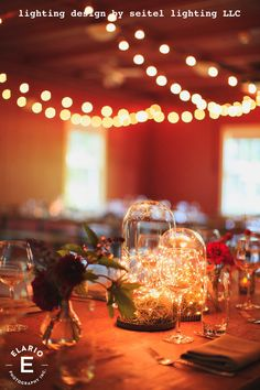 Suspended bistro lights by Seitel Lighting complement the fairy light table centerpieces by Crocus Hale Flowers. Lighted Centerpieces, Table Decorations, Bistro Lights, Light Table, Stables, Fairy Lights, Lighting Design, Getting Married, My Design