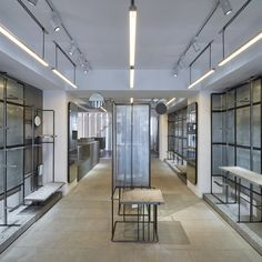 Shanghai studio Linehouse has combined metal rods and grey basalt stone to create display rails within French fashion brand Côte&Ciel's Hong Kong store.