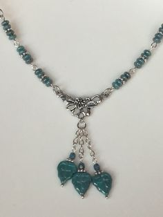 A personal favorite from my Etsy shop https://www.etsy.com/listing/488841852/turquoise-silver-leaf-flower-czech-glass