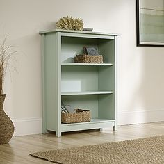 Two adjustable shelves. Detailing includes bead board back panel. Rainwater, yellow or cobblestone finish.