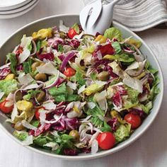 Big Italian Salad  Part green salad and part antipasto plate, this recipe combines lettuce, celery, onion, pepperoncini, olives, and cherry tomatoes all tossed in a dressing made with olive oil, vinegar, and a little mayonnaise. It's the perfect no-sweat starter salad for an elegant dinner party.