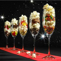This would be fun for a party table. Candy, snack, popcorn filled champagne glasses. (Picture only)