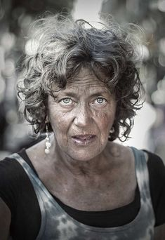 Photos of homeless people. Old lady, powerful face, intense eyes, expressive, expression, lines of life, wrinckles, a face with many stories to tell, beauty, portrait, photo