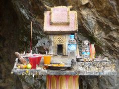 This Buddhist shrine is outside a cave in Laos where the US dropped their bombs (and giants partied)