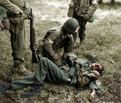 ww2 US Medics look over severely wounded or most likely KIA German