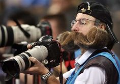A German press photographer with a handlebar moustache checks his pictures during the Russia vs South Korea group F preliminary round match of the 2007 Handball World Cup at the Porsche Arena in Stuttgart, southern Germany, 20 January Photographer Humor, Demotivational Posters, College Humor, Bad Timing, Funny Photos, Funny Images, Laugh Out Loud, The Funny, Make Me Smile