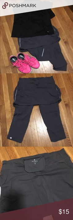 Athleta Capri workout pants Athleta Capri 2 in 1 workout pants. Capri stretch pants with built in skirt. Size XL. Small zip pocket in back to put your key, money or ID. Great condition. Worn only a couple of times. Smoke free, pet free home. Athleta Pants Capris