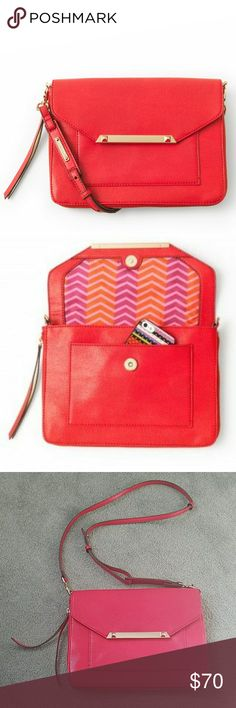 Stella and Dot Red Crossbody/Clutch Hardly used beautiful red bag with zipper detail on the side. Contains three separate pockets with   one zipper pocket within the main compartment. Magnetic clips help keep pockets closed. Comes with a detachable strap so you can wear it as a crossbody or clutch. No stains or tears. 10 inches across and 8 inches top to bottom. Slight fraying on the tag but still attached. Stella & Dot Bags Crossbody Bags