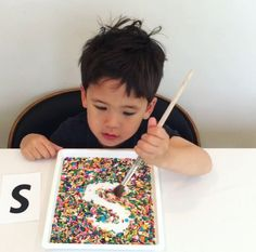 Letter writing with sprinkles age 3-5 Here's a fun way to practice writing letters! All you need are sprinkles and a paintbrush! (Salt or sand work well too!)