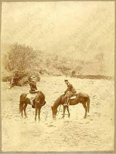 Nicholas and Alexandra on horseback
