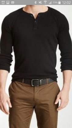 Simple but dressy. Black sweatshirt with black belt, brown pants, my guess is a black shoe a loafer or chukka I would look nice