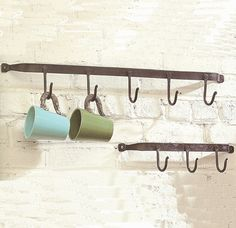 Understated rustic design makes this wall rack perfect for clearing clutter in your home. Use to hang everything from coats and hats in the hallway to soup and coffee mugs in the kitchen. These sturdy...