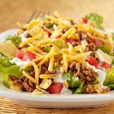 Taco Salad with homemade dressing.. I make mine the same way except I use bottled fat free Italian dressing....delish!
