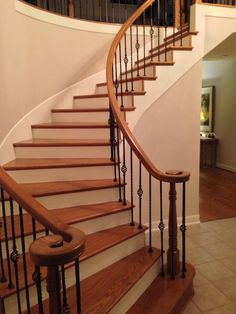 For this Houston area baluster swap, we removed the carpet and the treads. New full oak treads were installed, as well as painted risers, and a wall was built ad the end of the curved balcony. We replaced the oak caps and installed our PC6/1 and PC4/1 wrought iron balusters along with the refinished handrail. As you can see, the over all effect enriches the entire space.
