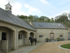Great idea to inset the doors of the stalls, leave the windows open without the rain getting in :) horse stables Equestrian Stables, Horse Stables, Horse Farms, Dream Stables, Dream Barn, Holiday Cottages To Rent, Stone Barns, Horse Property, Tallit