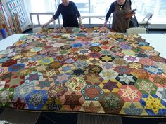 And here is an entire quilt made of EPP stars -- but notice that some of the hexagon shapes are not stars; they are just fussy-cut hexagons.