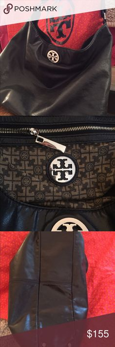 Tory Burch hand bag Beautiful, timeless bag by Tori Burch! The color is a nice soft black. Great condition. The top of the strap has a few small frays on it and the bottom silver feet are a little worn. Otherwise pretty perfect. It comes with the original duster bag too! Tory Burch Bags Shoulder Bags