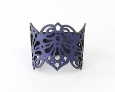 Leather cuff made of Red, Blue ,Purple or Turquoise colour leather laser cut in intricate design inspired by Victorian times and finished with love by hand. Measures 7, 7 1/2 or 8 inches(18,19 or 20 cm.) long and 2 1/4 inches(6 cm.) wide. Closes by press buttons in antique colour metal.
