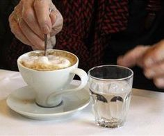 Drink 8 Glasses of Water a Day? Not So Fast:  A customer stirs a cup of coffee at a cafe in Vienna, Austria. The Viennese take it for granted but elsewhere it is rapidly becoming a rare commodity: crystal-clear water drunk straight from the tap. Vienna gets its water supply from alpine springs, some fed by glaciers, transported for over 100 miles without the aid of pumps or other mechanical means.