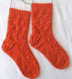 "I just bound off my Guava socks!  Start date: August 4, 2014   Completion date: August 14, 2014   Pattern: HiyaHiya Guava Socks (Cuff Down)   Yarn: Zwerger Garn Opal Solids 4-ply in a dull orange, overdyed with electric pink to make it fruitier   Needles: 2.5 mm 40"" HiyaHiya sharp circular for leg, 2.25 mm 40"" HiyaHiya sharp circular for heel and foot  --- hautecontre (Ravelry Name) said."
