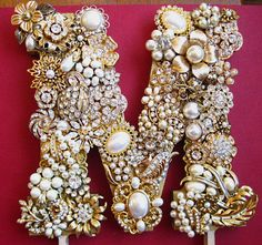 Wedding, Cake Topper, covered in Vintage Jewels, Gold, Crystal, Pearl,  Letter M Reserved for Andrea. $97.50, via Etsy.