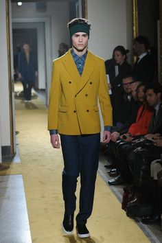 A model walks the runway during the Andrea Incontri show as a part of Milan Fashion Week Menswear Autumn/Winter 2014 on January 13, 2014 in ...