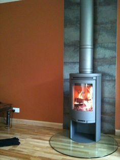 Here is a Contura 510:1 in grey with Poujoulat flue, a glass hearth and ceramic tiles from a DIY shed. (really nice too!) This was installed by Hagley Stoves staff a few years ago but it's still referred to on a daily basis.