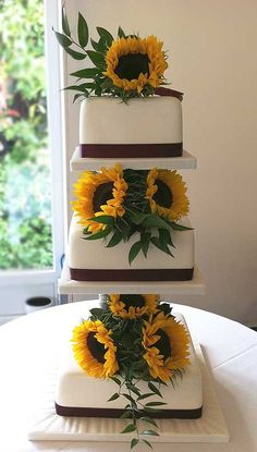 Wedding Cake with Sunflowers by Genuine Cakes
