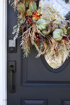 Our front porch might be small, but it sure does look good dressed up for fall! Find out exactly how to recreate this look and set the tone for the season. #fall #frontporch #falldecor #fallporch