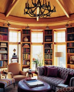 Install lights above bookshelves for a standout gallery-inspired vibe. Source: Elle Decor