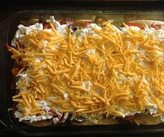 Ingredients  2 pounds ground beef, cooked and drained  1 (1.25-ounce) packet taco seasoning  4 ounces sour cream  4 ounces mayonnaise  8 ounces Cheddar cheese, shredded and divided  1 yellow onion, sliced  2 cups biscuit mix ( I would find something else for