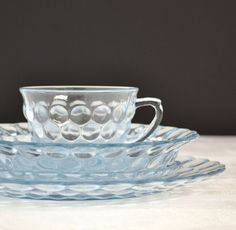 Anchor hocking blue bubble glass - tea cup, saucer, and plate Glass Tea Cups, Vintage Dinnerware, Anchor Hocking, Tea Cup Saucer, High Tea, Blue Sapphire, Tea Time, Vintage Items, Bubbles