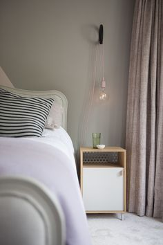 Ravenhill bedroom. Geometric wall, blush tones. Muuto E27 pendant with Hay Gym Hook. Ferm living bedside table.