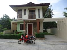 Liloan Single Detached In WoodlandPark Residences CHERIMOYA MODEL  BRINGING NATURE INTO YOUR HOMES  15 mins to SM Consolacion 10 mins to Private Schools 5 mins to mini markets  AMENITIES :  CLUBHOUSE WITH SWIMMING POOL GATE AND LANDSCAPE ENTRANCE TREE LINED STREETS PERIMETER FENCE GARDEN AND LANDSCAPE AREAS ACCESS TO WOODLAND AMENITIES LIKE TREKKING TRAILS AND PARKS  HOUSE SPECS :  3 BEDROOMS 2 TOILET AND BATH PORCH GARAGE AND GARDEN LANAI  LOT AREA : 142sqm FLOOR AREA : 80sqm