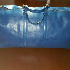 FIRM - Authentic LV Epi Blue Keep All 60 Minor flaws. Scuffs to the corners as shown and throughout the body. Interior is clean with no ink blots or major stains. Small handle rip but it does NOT affect overall use or function.   Lock & key NOT included TV: $1500 Louis Vuitton Bags Travel Bags