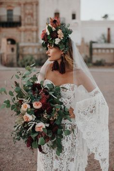 This styled shoot features bohemian inspiration at San Xavier Mission, a historic chapel in the Arizona desert with editorial gowns and bridal hats
