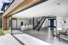 The large sliding glazed panels that face onto the garden blur the boundary between indoors and outdoors