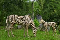 Driftwood horse  The Grazing Mare and Filly by ghoff24.deviantart.com. Front yard
