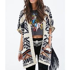 Forever 21 oversized open tribal fringe cardigan This is a soft sleeveless oversized cardigan sweater. The picture shows the detail of the tassel fringe on the side split. It has a tribal Aztec design print. Super soft cashmere feel. Like new Forever 21 Sweaters Cardigans