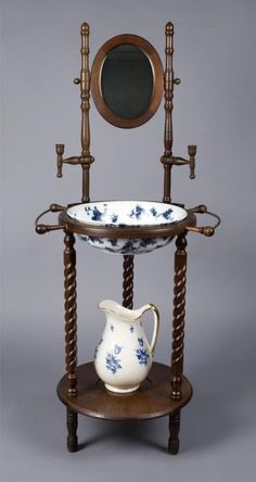 Fine Victorian Wash Stand, Pitcher  Basin: Finely carved with 3 barley twist legs, small oval mirror with 2 candle holders midway. Includes blue floral  gilt ceramic pitcher,  a flow blue  gilt highlighted Ridgeway basin