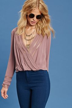 Forever 21 Contemporary - A woven top with a snap-buttoned plunging surplice…