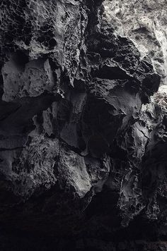 Rocky Cliffs with rough textures; organic surface pattern; dark nature photography: