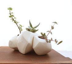 I'm pretty sure I need these: Succulent Rock Trio Planters in White. $150.00, via Etsy.