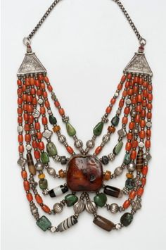 India   Seven strand necklace; large amber bead, silver, coral, turquoise and other stones   Mid 19th to mid 20th century   Possibly made in Ladakh