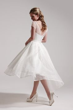 Gorgeous tea length wedding dress with dipped hem line by So Sassi for Sassi Holford