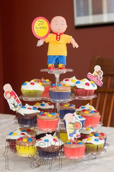 caillou cupcake | know...the tape is tacky butCaillou had to hold the sign