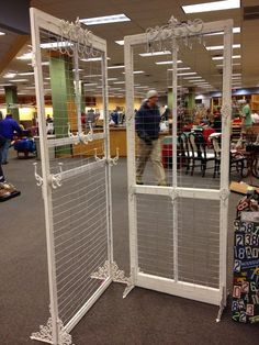 L brackets on the bottom with chicken wire screens and coat hooks ~ Vintage Show Off: Screen Door Displays