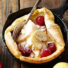 Finnish Baked Pancake: These oven-baked dessert pancakes are filled with fresh berries.