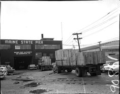 A September 1958 Press Herald photograph shows the entrance to the Maine State Pier near Commercial Street at a time when the pier was still the region's main cargo-shipping terminal. Portland Press Herald, Casco Bay, Commercial Street, Lighthouse, Maine, Adventure, Landscape, City, Outdoor